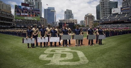 Future Marines from Recruiting Station San Diego take the oath of enlistment and receive NROTC scholarship checks at a pre-game ceremony hosted at Petco Park, San Diego, June 11, 2017. (U.S. Marine Corps Photo by Sgt. Taylor Morton/Released)