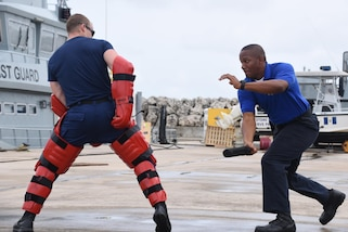 Steven Celestine, a member of the Commonwealth of Dominica Coast Guard, practices law enforcement techniques during Exercise Tradewinds 2017 at the Barbados Coast Guard Base in Bridgetown, Barbados, June 9, 2017. Tradewinds 2017 is a joint, combined exercise conducted in conjunction with partner nations to enhance the collective abilities of defense forces and constabularies to counter transnational organized crime, and to conduct humanitarian/disaster relief operations. (U.S. Coast Guard photo by Petty Officer 1st Class Melissa Leake/Released)