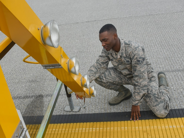 Airman 1st Class Isaiah Davis, 89th Operations Support Squadron airfield manager, checks the functionality of a runway signal at Joint Base Andrews, Md., June 7, 2017. The sign communicates to the arriving aircrew that a part of the flightline is closed due to construction and helps prevent accidents. (U.S. Air Force photo by Airman 1st Class Valentina Lopez)