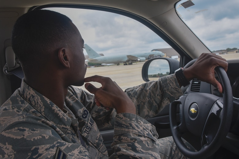 Airman 1st Class Isaiah Davis, 89th Operations Support Squadron airfield manager, drives on the flightline during a foreign object debris inspection at Joint Base Andrews, Md., June 7, 2017. FOD inspections are conducted every two hours to prevent even small debris causing serious aircraft damage. (U.S. Air Force photo by Airman 1st Class Valentina Lopez)