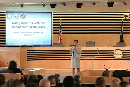 Emily Harman, Department of the Navy Office of Small Business Program director, delivers her keynote address during Industry Day at Corona City Hall. The Naval Surface Warfare Center (NSWC), Corona Division-sponsored event, organized in cooperation with Riverside Community College District Procurement Assistance Center, included a forecast of NSWC Corona future contracting/subcontracting opportunities as well as meet-and-greet sessions for suppliers to network with technical department personnel.