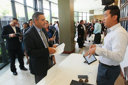 Ken Garber, PM Tec vice president, left, chats with Michael Tao, Naval Surface Warfare Center (NSWC), Corona Division Acquisition and Readiness Assessment Software Development Branch head, chat during Industry Day at Corona City Hall. Organized in cooperation with Riverside Community College District Procurement Assistance Center, the event included a keynote presentation by Emily Harman, Department of the Navy Office of Small Business Program director, a forecast of NSWC Corona future contracting/subcontracting opportunities as well as a series of meet-and-greet sessions for suppliers to network with technical department personnel.