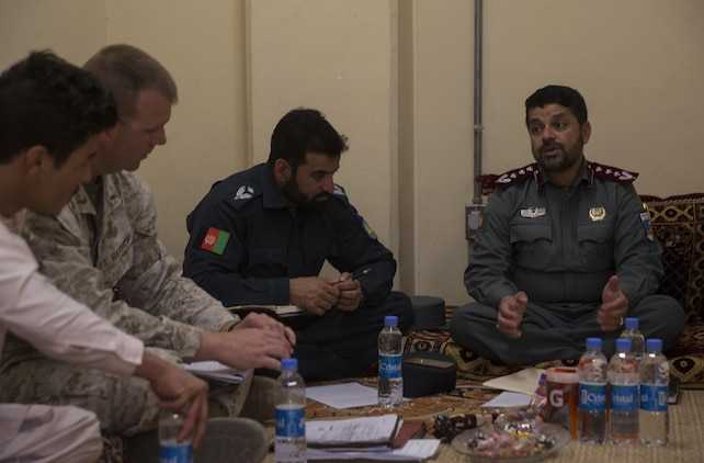 A U.S. Marine advisor with Task Force Southwest receives feedback from his Afghan National Police counterpart at Bost Airfield, Afghanistan, May 15, 2017, where they discussed classes that the advisors will teach over the next few weeks. The classes will consist of the various explosive ordnance disposal techniques as well as how to properly use their EOD robot and vallon metal detectors. Task Force Southwest, comprised of approximately 300 Marines and Sailors from II Marine Expeditionary Force, are training, advising and assisting the Afghan National Army 215th Corps and the 505th Zone National Police. (U.S. Marine Corps photo by Sgt. Justin T. Updegraff)