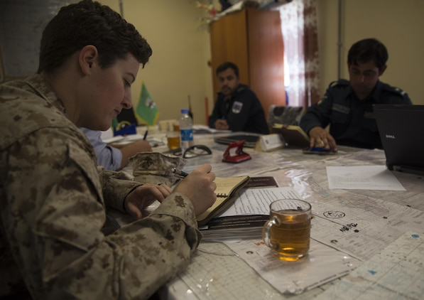 A U.S. Marine advisor with Task Force Southwest jots down notes during a meeting at Bost Airfield, Afghanistan, May 16, 2017. The advisors discussed the various checkpoints in the area and ensured that the proper steps were being taken to promote security in the region. Task Force Southwest, comprised of approximately 300 Marines and Sailors from II Marine Expeditionary Force, are training, advising and assisting the Afghan National Army 215th Corps and the 505th Zone National Police. (U.S. Marine Corps photo by Sgt. Justin T. Updegraff)