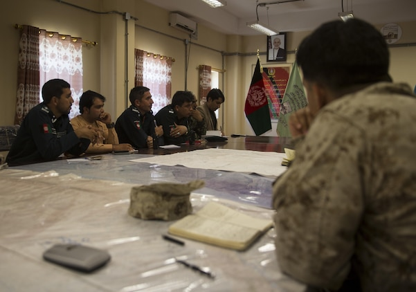 A U.S. Marine advisor, right, with Task Force Southwest, listens to his counterparts during an information operations meeting at Bost Airfield, Afghanistan, May 20, 2017. Task Force Southwest, comprised of approximately 300 Marines and Sailors from II Marine Expeditionary Force, are training, advising and assisting the Afghan National Army 215th Corps and the 505th Zone National Police. (U.S. Marine Corps photo by Sgt. Justin T. Updegraff)