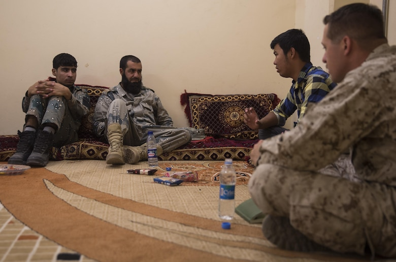 A U.S. Marine advisor with Task Force Southwest goes over what will be covered during the bi-weekly course with his Afghan National Police counterparts at Bost Airfield, Afghanistan, May 18, 2017. During the next few weeks, they will learn various explosive ordnance disposal techniques as well as how to properly use their EOD robot and vallon metal detectors. Task Force Southwest, comprised of approximately 300 Marines and Sailors from II Marine Expeditionary Force, are training, advising and assisting the Afghan National Army 215th Corps and the 505th Zone National Police. (U.S. Marine Corps photo by Sgt. Justin T. Updegraff)