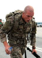 Spc. Zachary Elenchin, a Soldier representing 3rd Medical Command, in the U.S. Army Central Best Warrior competition, turns around at the six-mile mark of the ruck march at Camp Buehring, Kuwait, May 24. Competitors had to complete a 12-mile ruck march as one of four events testing physical fitness and fortitude. (Photo by U.S. Army Sgt. Kelly Gary, 29th Infantry Division Public Affairs)