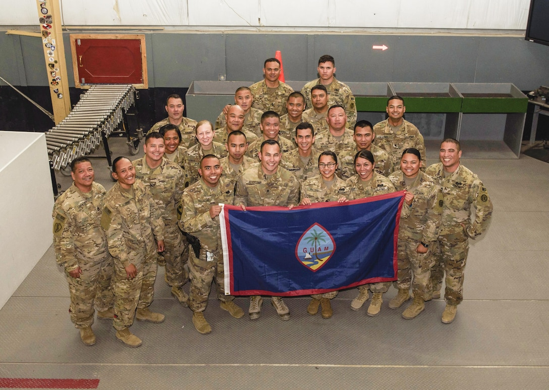 Soldiers assigned to the 368th Military Police Company, Detachment 3, from Guam pose for a photo on Bagram Airfield, Afghanistan, June 7, 2017. Detachment 3 has been conducting the customs mission on Bagram and Kandahar Airfields. Just about everyone supporting the Resolute Support and Operation Freedom's Sentinel mission in Afghanistan has passed the careful inspections of this vigilant team. (U.S. Air Force photo by Staff Sgt. Benjamin Gonsier)