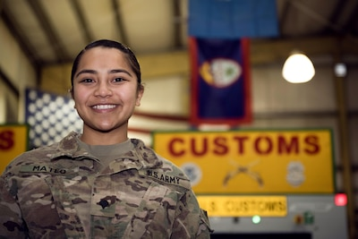U.S. Army Spc. Michelle Mateo is deployed to Bagram Airfield, Afghanistan, as a customs agent for the base. She is assigned to the 368th Military Police Company, which is located on Guam, a 210-square-mile island in the middle of the Pacific Ocean. As a customs agent, Mateo inspected personnel and cargo leaving Afghanistan and the Central Command area of responsibility. (U.S. Air Force photo by Staff Sgt. Benjamin Gonsier)