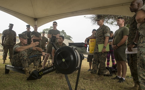 Lt. Col. Paul Melchior, the Force Fitness division action officer, demonstrates the proper form when using the rowing machine at the Force Fitness Instructor Promotion Tour on Marine Corps Base Hawaii June 8, 2017. The rowing machine will supplement the 3-mile run portion of the Physical Fitness Test for Marines on light or limited duty, as well as presenting an option for Marines older than 46. (Photo by Lance Cpl. Luke Kuennen)