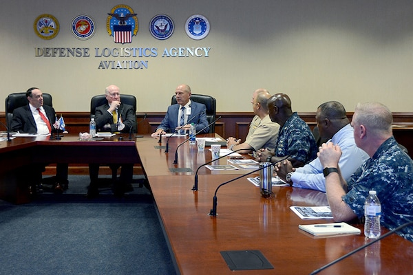 Graybeards, retired Rear Adm. Michael Finley and retired Vice Adm. Michael Malone (from left to right), receive a brief on Defense Logistics Agency Aviation's logistical support of the Boeing F/A-18E and F/A-18F Super Hornet by DLA Aviation Deputy Commander Charlie Lilli, Chief of Staff at DLA Aviation Steve Kinskie, along with Navy Cmdr. Eric Lockett, Operations Officer, Navy Customer Facing Division, Customer Operations Directorate, DLA Aviation and Navy Capt. Mark Harris, Chief, Navy Customer Facing Division, Customer Operations Directorate, DLA Aviation June 6, 2017 at Defense Supply Center Richmond, Virginia.