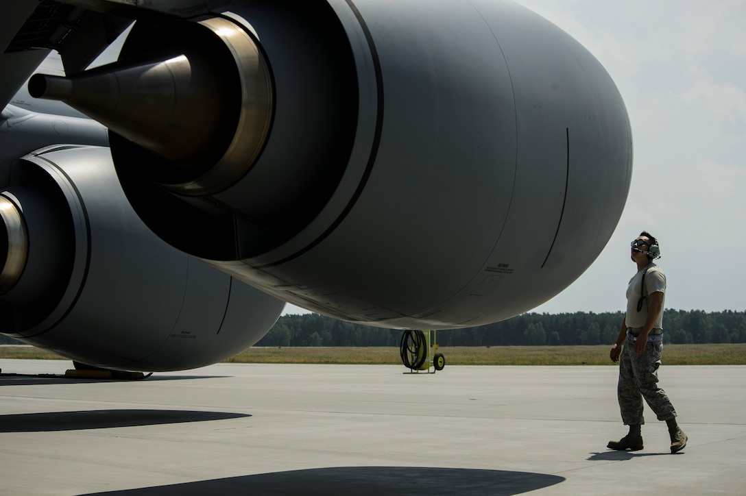 Tech. Sgt. Min An, 459th Aircraft Maintenance Squadron crew chief, is part of the Total Force Citizen Airmen team conducts a visual inspection of a KC-135R Stratotanker during BALTOPS exercise at Powidz Air Base, Poland, June 12, 2017. The exercise is designed to enhance flexibility and interoperability, to strengthen combined response capabilities, as well as demonstrate resolve among Allied and Partner Nations' forces to ensure stability in, and if necessary defend, the Baltic Sea region. (U.S. Air Force photo by Staff Sgt. Jonathan Snyder)