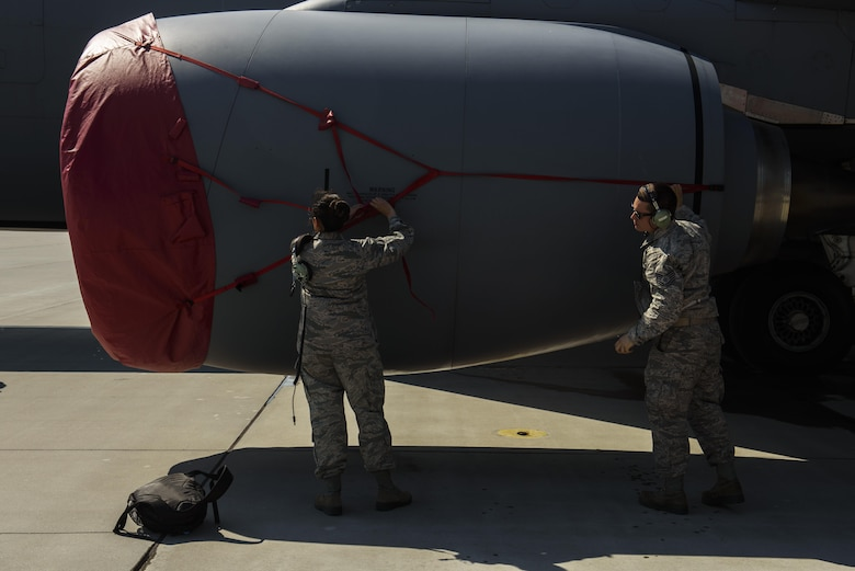Staff Sgt Sandra Henriquez, left, 459th Aircraft Maintenance Squadron aero repair, and Tech. Sgt. Aaron Frank, right, 459th Aircraft Maintenance Squadron avionics comm/nav technician, both are part of the Total Force Citizen Airmen team puts the covers over a KC-135R Stratotanker engine during BALTOPS exercise at Powidz Air Base, Poland, June 12, 2017. The exercise is designed to enhance flexibility and interoperability, to strengthen combined response capabilities, as well as demonstrate resolve among Allied and Partner Nations' forces to ensure stability in, and if necessary defend, the Baltic Sea region. (U.S. Air Force photo by Staff Sgt. Jonathan Snyder)