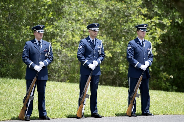 MacDill Air Force Base U.S. Air Force Honor Guardsmen prepare to perform as the firing party during a funeral service at Florida National Cemetery, June 9, 2017. As a part of rendering honors for a retiree, Honor Guardsmen fired three volleys during the playing of Taps. (U.S. Air Force Photo by Airman 1st Class Rito Smith)