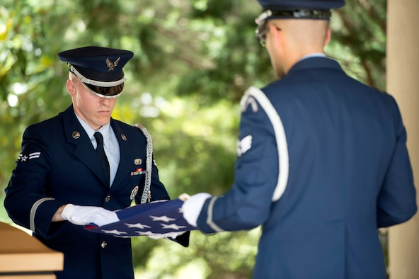 MacDill Air Force Base U.S. Air Force Honor Guardsmen perform a two-man flag fold during a funeral service at Florida National Cemetery, June 9, 2017. The flag fold was performed as part of a five-man detail honoring the passing of a United States Air Force retiree. (U.S. Air Force Photo by Airman 1st Class Rito Smith)