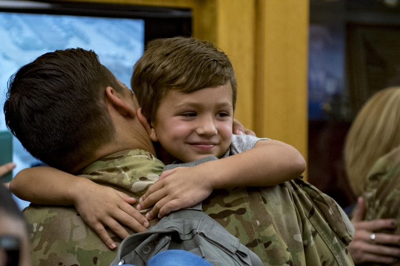 Quinn Conrad greets his father, Staff Sgt. Adam Conrad, 41st Rescue Squadron special missions aviator, as he returned home from a deployment, June 8, 2017, at Moody Air Force Base, Ga. The 41st and 71st Rescue Squadrons were recently deployed to Southwest Asia where they provided combat search and rescue capabilities in support of Operation Inherent Resolve. (U.S. Air Force photo By Airman 1st Class Daniel Snider)