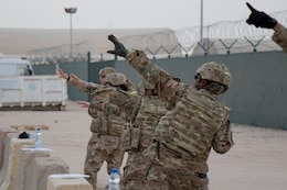 Soldiers of the 369th Sustainment Brigade practice hand grenade throwing skills at Camp Arifjan Kuwait, May 20, 2017. Basic Soldier tasks and skills are part of the brigade's Small Unit Leader Training program. (U.S. Army photo by Sgt. Cesar E. Leon)