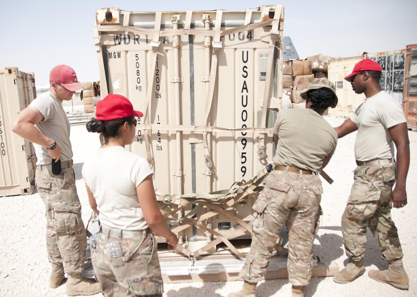 Soldiers of the 824th Quartermaster Company secure a container with cargo netting for aerial delivery at Al Udeid Air Base, Qatar on April 19, 2017. Aerial delivery operations are essential for getting supplies to troops in the Middle East when conventional means of transportation are not feasible. (U.S. Army photo by Sgt. Jeremy Bratt)