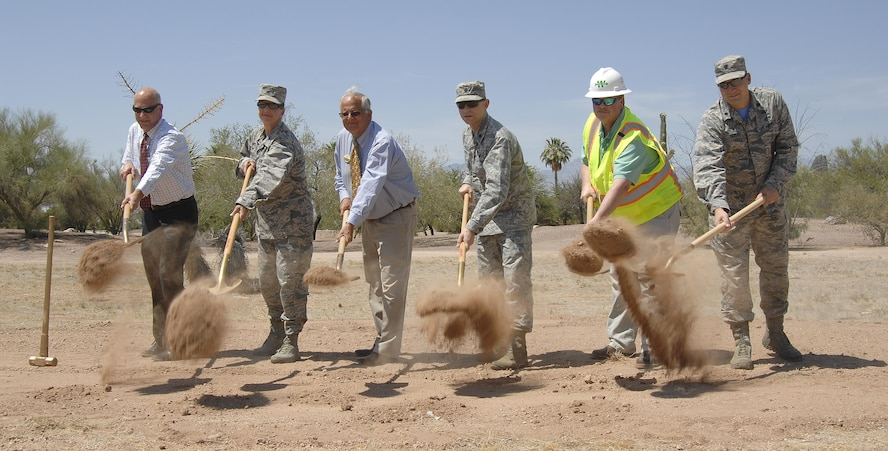 Leadership from 355th Mission Support Group and 355th Force Support Squadron along with contractors perform a ceremonial ground breaking for the Inn at Davis-Monthan Air Force Base, Ariz., June 9, 2017. Construction of the new lodging facilities are scheduled to be completed between January and February of 2019. (U.S. Air Force photo by Airman 1st Class Frankie Moore)