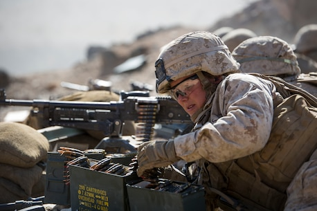 MARINE CORPS AIR GROUND COMBAT CENTER TWENTYNINE PALMS, California – Cpl. Savannah Chase, a machine gunner with Weapons Platoon, Alpha Company, 1st Battalion, 8th Marine Regiment, prepares ammunition for an M240B Machine Gun during a reinforced company assault at Range 400 aboard Marine Corps Air Ground Combat Center Twentynine Palms, California, May 8, 2017. The Marines conducted a company level assault reinforced by machine guns, vehicles, mortars and snipers as part of Integrated Training Exericse 3-17. ITX is a training evolution conducted five times a year to enhance the lethality and co-operability between the four elements of a Marine Air Ground Task Force. (U.S. Marine Corps photo by Cpl. Jesus Sepulveda Torres)