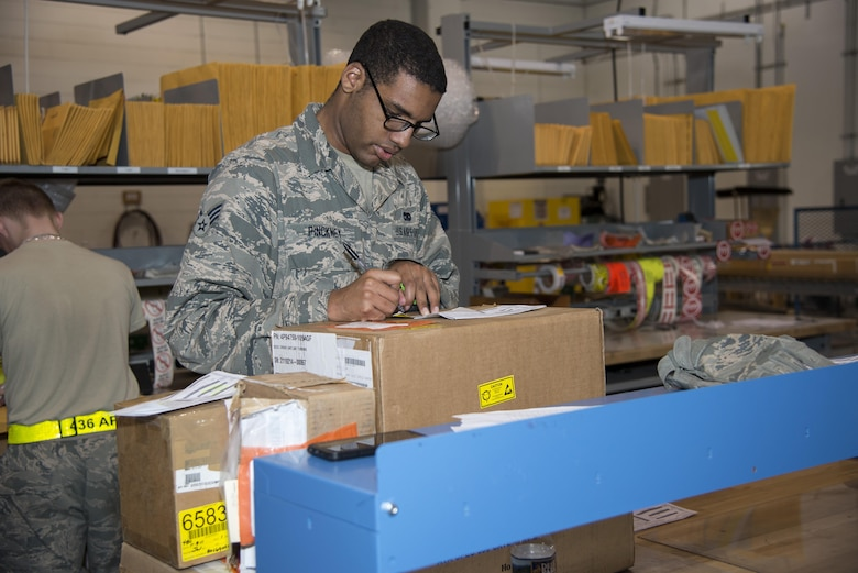 Senior Airman Gerard Pinckney, 436th Aerial Port Squadron traffic management specialist, calculates dimensions needed for boxing an item Jan. 12, 2017, at the aerial port on Dover Air Force Base, Del. The squadron has a box-making machine, which allows improved precision packing of cargo. (U.S. Air Force photo by Senior Airman Aaron J. Jenne)