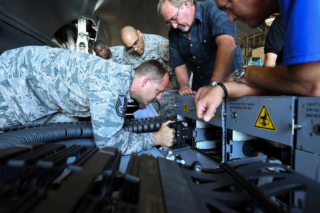 388th Maintenance Group Loading Standardization Crew Member Master Sgt. Ryan Hanner attaches the chute to an ammunition bulk loader used to load cannon rounds onto the F-35A Lightning II fighter aircraft, Hill Air Force Base, Utah, June 7, 2017. (U.S. Air Force photo/R. Nial Bradshaw)