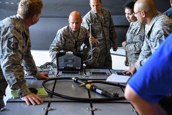 388th Maintenance Group Loading Standardization Crew Member Master Sgt. Jeffrey Taggart reads technical data during a validation and verification process of an ammuntion bulk loader used to load cannon rounds onto the F-35A Lightning II fighter aircraft, Hill Air Force Base, Utah. (U.S. Air Force photo/R. Nial Bradshaw)