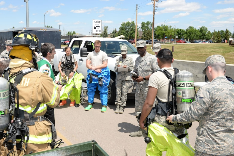 28th Bomb Wing Inspection Team members brief Airmen from the 28th Medical Operations Squadron bioenvironmental engineering response team during an exercise at Ellsworth Air Force Base, S.D., June 7, 2017. The purpose of the exercise was to evaluate emergency management response procedures in the event of a terrorist attack at the installation. (U.S. Air Force photo by Staff Sgt. Hailey Staker)