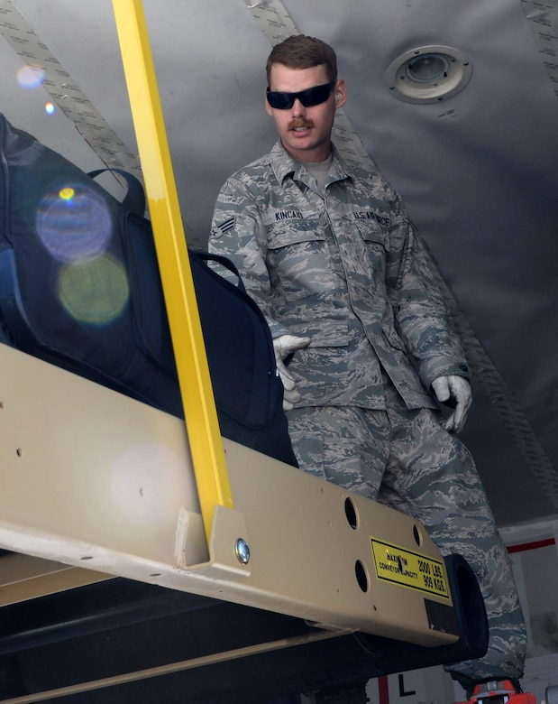Senior Airman Jeremiah Kincaid, a vehicle management journeyman assigned to the 28th Logistics Readiness Squadron, loads luggage inside of an aircraft departing for Royal Air Force Fairford, United Kingdom June 3, 2017. Approximately 100 Airmen from Ellsworth Air Force Base, S.D. departed in support of multiple joint, multinational exercises. (U.S. Air Force photo by Senior Airman Denise M. Jenson)