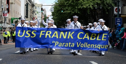 PORTLAND, Ore. (June 10, 2017) – Sailors assigned to the submarine tender USS Frank Cable (AS 40) march in the Grand Floral Parade during Rose Festival Fleet Week in Portland, Ore., June 10. The festival and Portland Fleet Week are a celebration of the sea services with Sailors, Marines and Coast Guard members from the U.S. and Canada making the city a port of call.  (U.S. Navy photo by Mass Communication Specialist 1st Class Eva-Marie Ramsaran/Released)