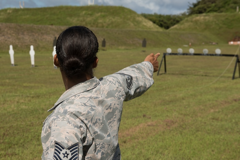 U.S. Air Force Tech. Sgt. Yerida Vazquez, 36th Security Forces Squadron NCO in charge of combat arms, visualizes making a single-arm pistol shot before a shooting competition April 29, 2017, at Naval Computer and Telecommunications Station, Guam. During the relay stage of the shooting competition, four-person teams raced against the clock as they switched between the rifle, shotgun and two pistol stages. (U.S. Air Force photo by Airman 1st Class Jacob Skovo)