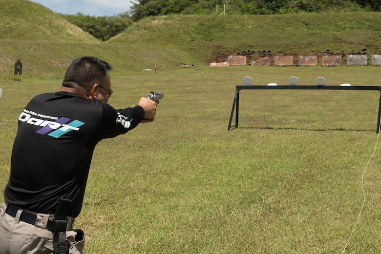 Capt. Scott Wade, Guam Police Department, fires a handgun April 29, 2017, at Naval Computer and Telecommunications Station, Guam. Members of the GPD hosted this friendly shoot-off to bring law enforcement from around the island together. (U.S. Air Force photo by Airman 1st Class Jacob Skovo)