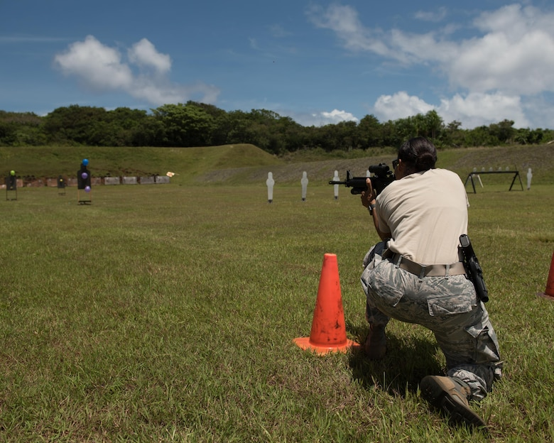 U.S. Air Force Tech. Sgt. Yerida Vazquez, 36th Security Forces Squadron NCO in charge of combat arms, fires an M4 carbine at balloon targets April 29, 2017, at Naval Computer and Telecommunications Station, Guam. The balloons, varying sizes and movement in the wind, increased the difficulty of the rifle portion of the three gun shoot-off. (U.S. Air Force photo by Airman 1st Class Jacob Skovo)