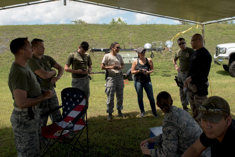 Airmen from the 36th Security Forces Squadron speak with the Guam Police Department Chief of Police Joseph Cruz April 29, 2017, at Naval Computer and Telecommunications Station, Guam. Members of the GPD hosted this friendly shoot-off to bring law enforcement from around the island together. (U.S. Air Force photo by Airman 1st Class Jacob Skovo)