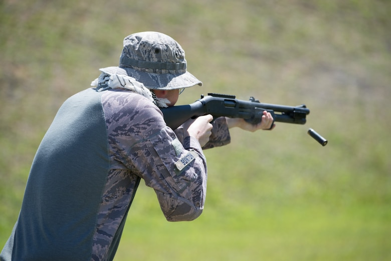 U.S. Air Force Senior Airman Caleb Bunton, 736th Security Forces fire team leader, fires an M870 shotgun April 29, 2017, at Naval Computer and Telecommunications Station, Guam. The 736th SFS won the four-stage team relay of the friendly shooting competition hosted by members of the Guam Police Department. (U.S. Air Force photo by Airman 1st Class Jacob Skovo)