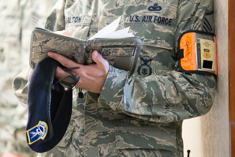 U.S. Air Force Master Sgt. Justin Carlton, 36th Security Forces wing inspection team member, notes the performance of Airmen during an emergency management exercise May 11, 2017, at Andersen Air Force Base, Guam. WIT members are highly-skilled members of their career field tasked to evaluate their unit's  response to exercise scenarios. (U.S. Air Force photo by Airman 1st Class Jacob Skovo)