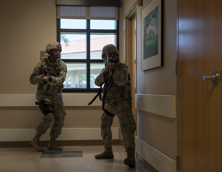 U.S. Air Force Staff Sergeants Gene McLaurin and Bianca Doblado, 36th Security Forces Squadron, search for additional threats during an emergency management exercise May 11, 2017, at Andersen Air Force Base, Guam. When known active shooters are no longer a threat, SFS Airmen clear the building to ensure the area is safe. (U.S. Air Force photo by Airman 1st Class Jacob Skovo)