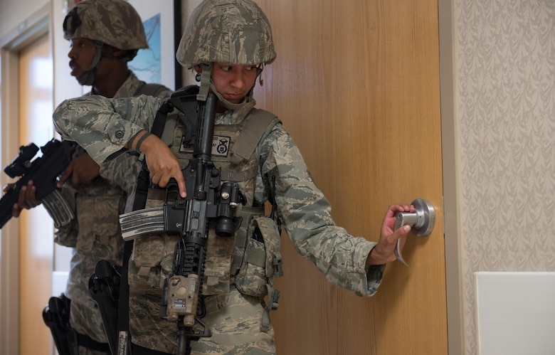 Staff Sgt. Bianca Doblado, 36th Security Forces Squadron, searches for threats during an emergency management exercise May 11, 2017, at Andersen Air Force Base, Guam. When known active shooters are no longer a threat, SFS Airmen clear the building to ensure the area is safe. (U.S. Air Force photo by Airman 1st Class Jacob Skovo)