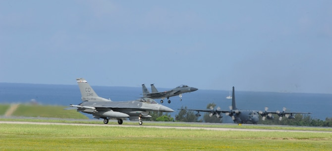 A U.S. Air Force F-16 Fighting Falcon assigned to the 120th Fighter Squadron, Buckley Air Force Base, F-15 Eagle assigned to the 44th FS, and an MC-130H Combat Talon II assigned to the 1st Special Operations Squadron conduct operations on the flightline June 7, 2017, at Kadena Air Base, Japan. The variety of aircraft stationed on and temporarily assigned to Kadena assist with maintaining Kadena's premier air presence in the Pacific region. (U.S. Air Force photo by Senior Airman Lynette M. Rolen)