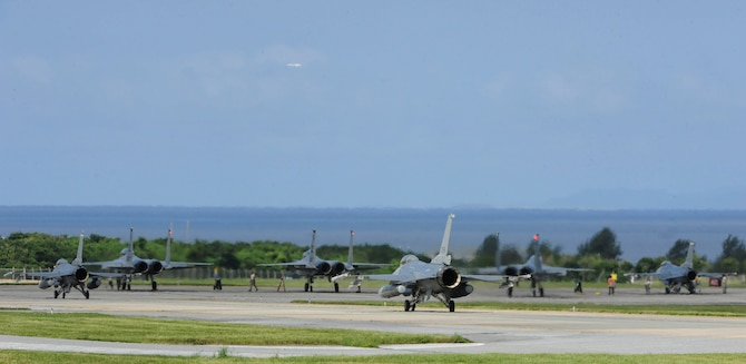 U.S. Air Force F-16 Fighting Falcons assigned to the 120th Fighter Squadron, Buckley Air Force Base, and F-15 Eagles assigned to the 44th Fighter Squadron receive final checks during a training sortie June 7, 2017, at Kadena Air Base, Japan. Kadena is the Keystone of the Pacific, with aircraft capable of supporting multiple missions and exercises throughout the Pacific area of responsibility. (U.S. Air Force photo by Senior Airman Lynette M. Rolen)