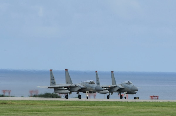 U.S. Air Force F-15 Eagles assigned to the 67th Fighter Squadron prepare to take off down the runway June 7, 2017, at Kadena Air Base, Japan. The F-15 is a classic all-weather, highly maneuverable war-fighting jet capable of being equipped with a variety of air-to-air weaponry. (U.S. Air Force photo by Senior Airman Lynette M. Rolen)