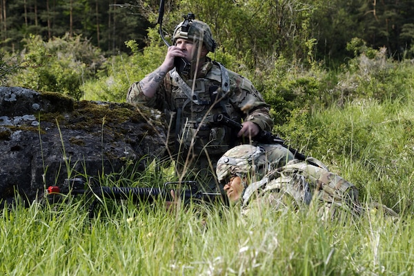 Soldier assigned to 1st Battalion, 501st Aviation Regiment, transmits information via field radio during Exercise Combined Resolve VIII, at Hohenfels Training Area, Germany, June 8, 2017 (U.S. Army/Michael Bradley)
