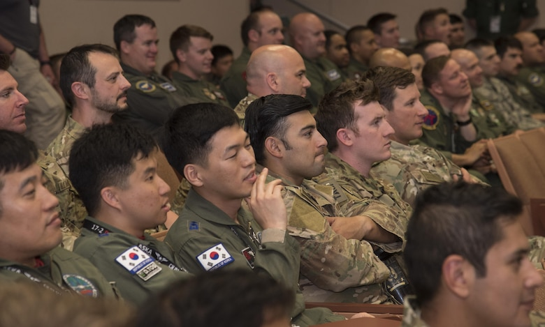 Pilots listen to a mass briefing during the large force exercise Red Flag-Alaska 17-2 at Eielson Air Force Base, Alaska, June 7, 2017. U.S. service members from all branches and several air forces from other countries including the Royal Thai, Republic of Korea, Japan Air Self-Defense Force, Finland, Denmark and Israel's air forces. They worked together to improve their tactical fluidity as they work cohesively, executing the objective. Exercises of this nature are vital to maintaining peace and stability in the Indo-Asia-Pacific theatre and signifies our continued commitment to the Pacific. (U.S. Air Force photo by Airman 1st Class Sadie Colbert)