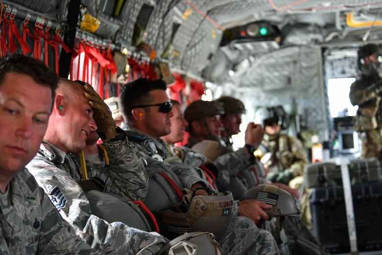 U.S. Air Force Airmen assigned to the 435th Contingency Response Group sit inside a U.S. Army CH-47 Chinook during exercise Saber Strike 17 at Lielvarde Air Base, Latvia, June 10, 2017. The 435th CRG Airmen parachuted out of the Chinook to prepare them for such operations when deployed. Saber Strike 17 highlights the inherent flexibility of ground and air forces to rapidly respond to crises allowing for the right presence where it is needed, when it is needed. (U.S Air Force photo by Senior Airman Tryphena Mayhugh)