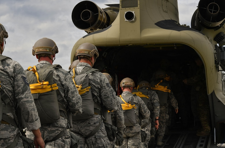 U.S. Air Force Airmen assigned to the 435th Contingency Response Group load into a U.S. Army CH-47 Chinook during exercise Saber Strike 17 at Lielvarde Air Base, Latvia, June 10, 2017. The 435th CRG sends paratroopers to austere locations to determine if an area can be safely used as an airfield. Saber Strike 17 promotes regional stability and security, while strengthening partner capabilities and fostering trust. (U.S Air Force photo by Senior Airman Tryphena Mayhugh)