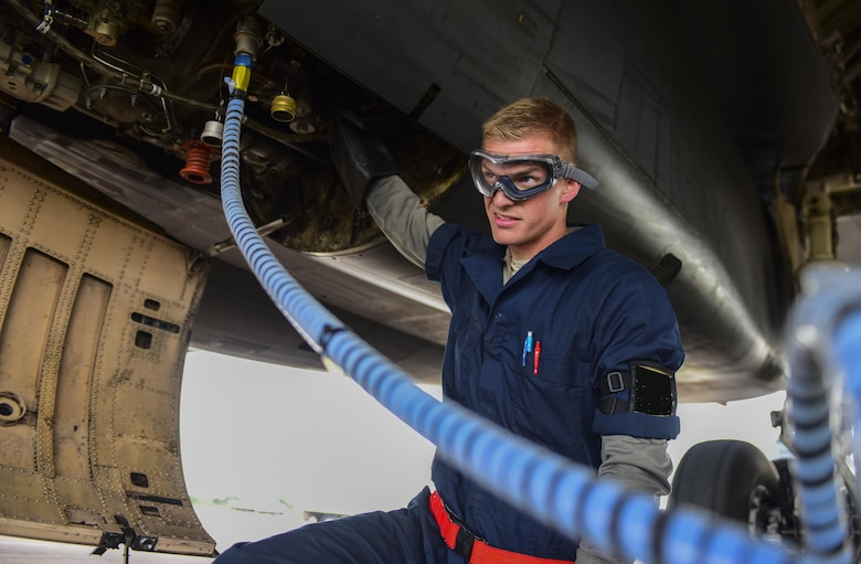 U.S. Air Force Airman 1st Class John Parker, 28th Aircraft Maintenance Squadron assistant dedicated crew chief, services the oil on a B-1B Lancer from Ellsworth Air Force Base at Royal Air Force Fairford, U.K., June 7, 2017. Airmen from the 28th Aircraft Maintenance Squadron are supporting bomber assurance and deterrence missions in the European theatre that combine training opportunities and improve interoperability among participating NATO allies and regional partners. (U.S. Air Force photo by Airman 1st Class Randahl J. Jenson)