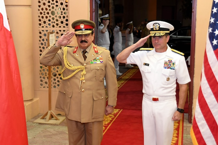 His Majesty, King Hamad bin Isa Al Khalifa, the King of the Kingdom of Bahrain, and Vice Adm. Kevin M. Donegan, commander of U.S. 5th Fleet salute during the Kingdom of Bahrain's national anthem after arriving to discuss operations in the U.S. 5th Fleet area of operations and coalition operations to defeat ISIS, June 12. The King was accompanied by two of his sons, His Highness Brig. Gen. Shaikh Nasser bin Hamad Al Khalifa, Commander of the Royal Guard, and His Highness Maj. Shaikh Khaled bin Hamad Al Khalifa, Commander of the Royal Guard Special Force; the Commander-in-Chief of the Bahrain Defense Force, His Excellency Field Marshal Shaikh Khalifa bin Ahmed Al Khalifa; and the Commander of the Bahraini Royal Navy, His Excellency Rear Adm. Shaikh Khalifa bin Abdullah Al Khalifa. Bahrain has been a partner with the United States in regional maritime security for nearly 70 years.