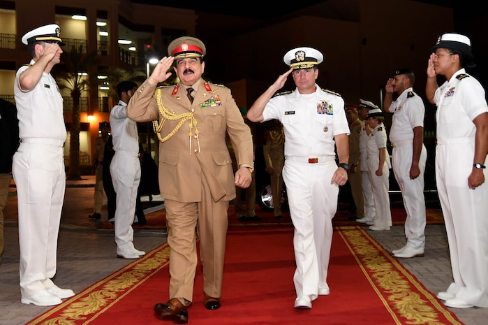 His Majesty, King Hamad bin Isa Al Khalifa, the King of the Kingdom of Bahrain, passes through sideboys with Vice Adm. Kevin M. Donegan, commander of U.S. 5th Fleet during a visit to discuss operations in the U.S. 5th Fleet area of operations and coalition operations to defeat ISIS, June 12. The King was accompanied by two of his sons, His Highness Brig. Gen. Shaikh Nasser bin Hamad Al Khalifa, Commander of the Royal Guard, and His Highness Maj. Shaikh Khaled bin Hamad Al Khalifa, Commander of the Royal Guard Special Force; the Commander-in-Chief of the Bahrain Defense Force, His Excellency Field Marshal Shaikh Khalifa bin Ahmed Al Khalifa; and the Commander of the Bahraini Royal Navy, His Excellency Rear Adm. Shaikh Khalifa bin Abdullah Al Khalifa. Bahrain has been a partner with the United States in regional maritime security for nearly 70 years.