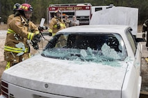 Staff Sgt. Manuel Santana, a firefighter with the 514th Civil Engineer Squadron, uses a halligan tool to break a vehicle window during a basic vehicle extrication training exercise at the Combat Readiness Training Center at Gulfport, Mississippi, in support of Crisis Response 2017 March 7, 2017. Close to 700 AMC Airmen from the 514th Air Mobility Wing, 305th Air Mobility Wing, 87th Air Base Wing, and the 621st Contingency Response Wing at Joint Base McGuire-Dix-Lakehurst, N.J., are participating in the mobilization exercise Crisis Response 2017. The primary goal of this exercise is for the four wings to deploy to an austere location and set up and sustain combat air mobility operations. (U.S. Air Force photo by Master Sgt. Mark C. Olsen/Released)