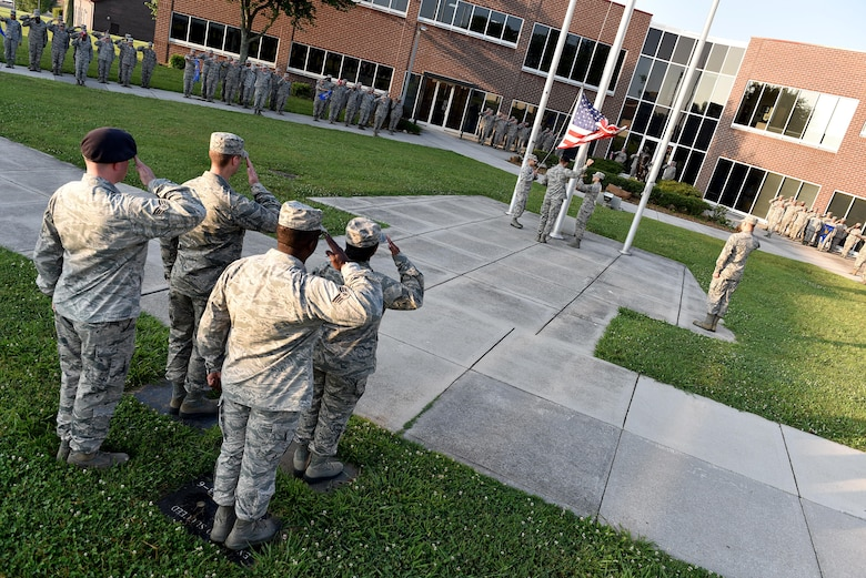 Senior Airmen in Airman Leadership School, classes 17-6 and 17-7 raise the flag, June 13, 2017, during morning reveille at the I.G. Brown Training and Education Center in Louisville, Tenn. About 42 Airmen in 17-6 will graduate their phase-two portion of the blended-learning course during a banquet this Friday. There are 163 Airmen in Class 17-7, undergoing the five-week in-resident course, which holds their graduation banquet June 29. (U.S. Air National Guard photo by Master Sgt. Mike R. Smith)